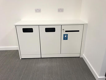 A low-level run of Freewall storagewall. The doors are fitted for general recycling. One of these doors is fitted with a small post slot, used for confidential waste disposal.