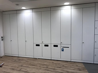 A run of Freewall storagewall, the centre units are split level, with the bottom doors being fitted for general recycling. One of these bottom doors is fitted with a small post slot, used for confidential waste disposal.