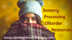 A girl in a cozy hat and blanket; Sensory Processing Disorder Resources