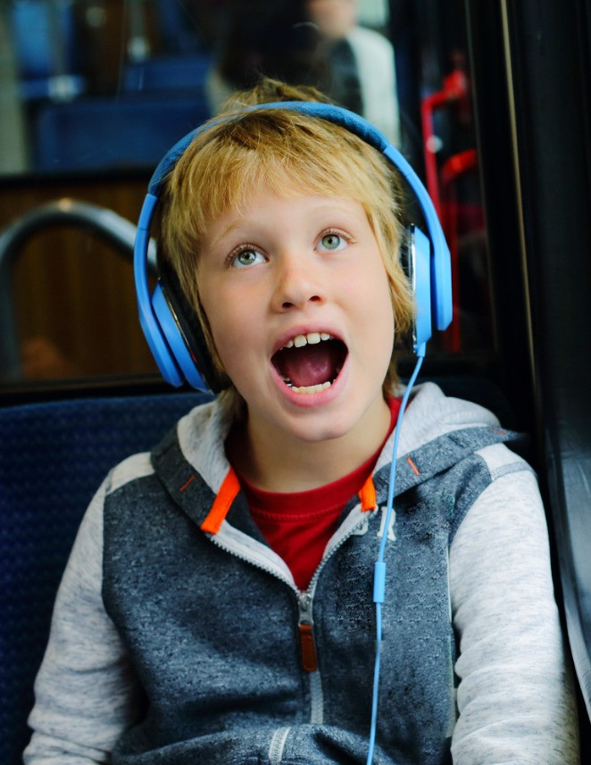 Boy with autism wearing headphones