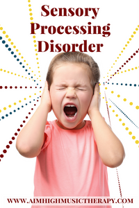 Girl with hands over ears; sensory processsing disorder