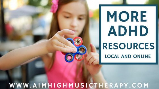More ADHD Resources: Local and Online. Shows a girl playing with fidget spinners