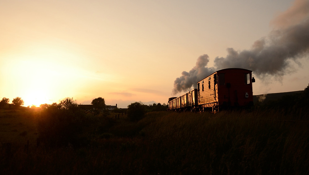 A demonstration freight train heads into the setting sun.