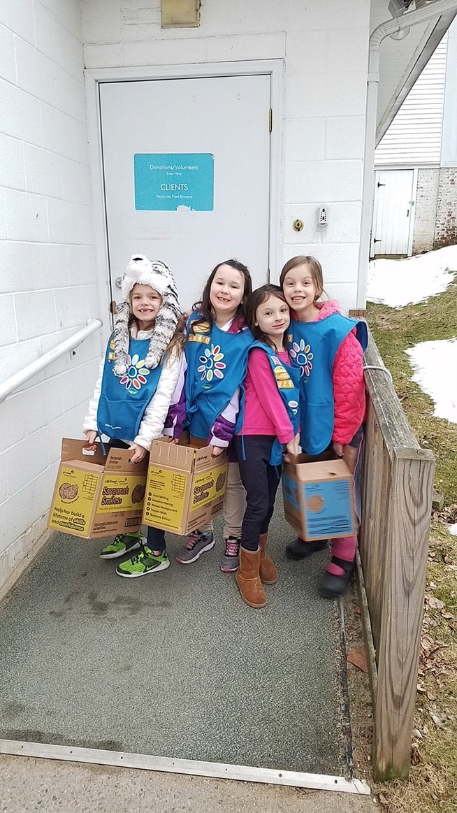 Girl Scout Troop 64640 from Granby/South Hadley visited us Saturday with a donation of Girl Scout Co