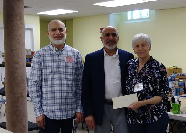 Dr. Bajwa and Dr. Kareem present checks from Muslim families in South Hadley totaling $1200!