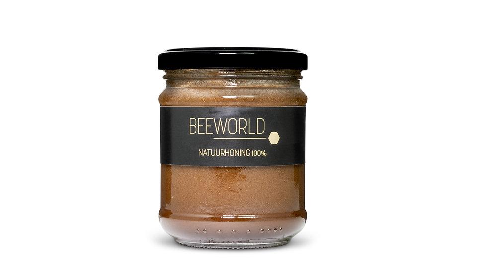 Honing met kaneelpoeder