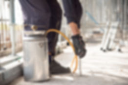Close-up Of Pest Control Worker Hand Hol