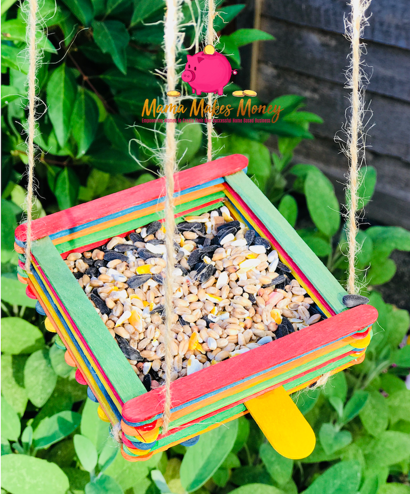 Fill your lollipop bird feeder with seeds and hang it in the garden