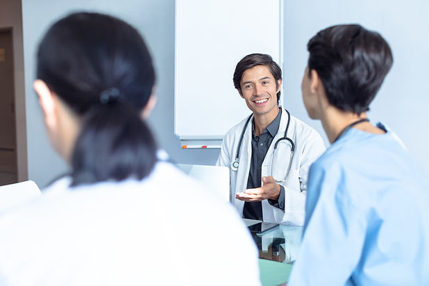 happy-male-caucasian-doctor-talking-to-d