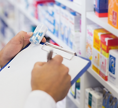 pharmacist-writing-on-clipboard-and-hold