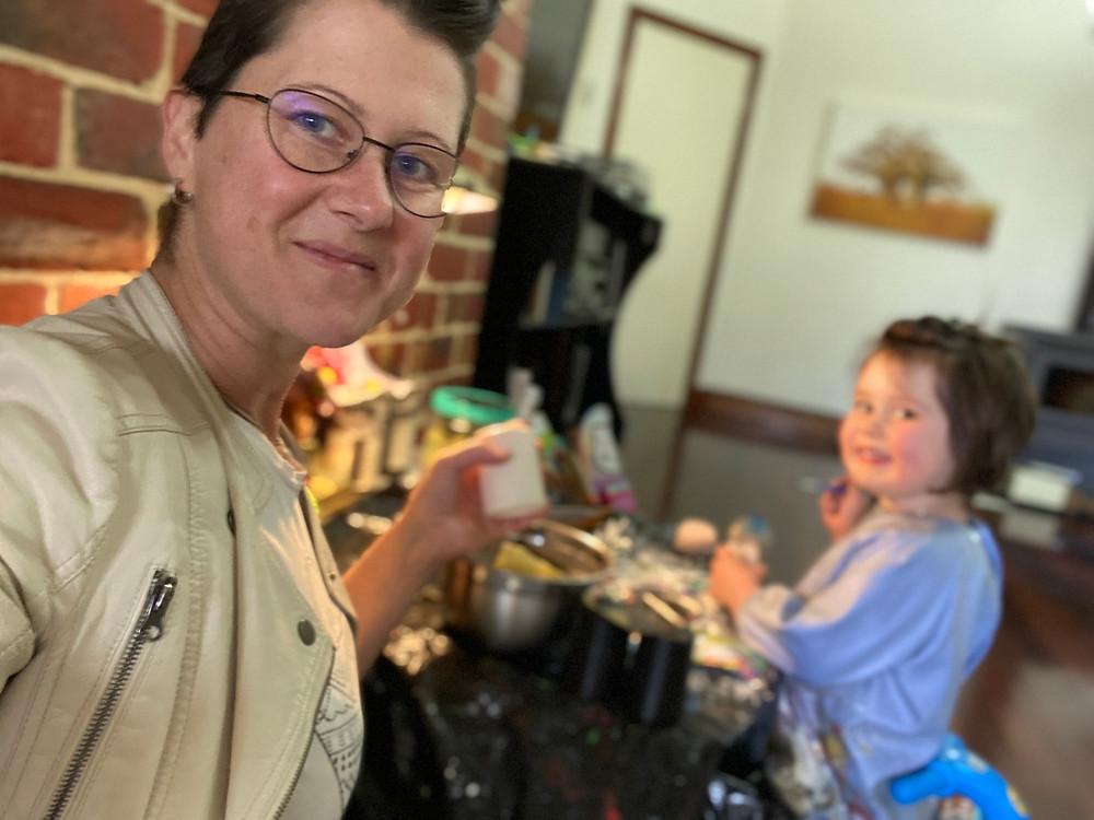 Founder Shannon working on Pronto prototypes while her daughter is painting