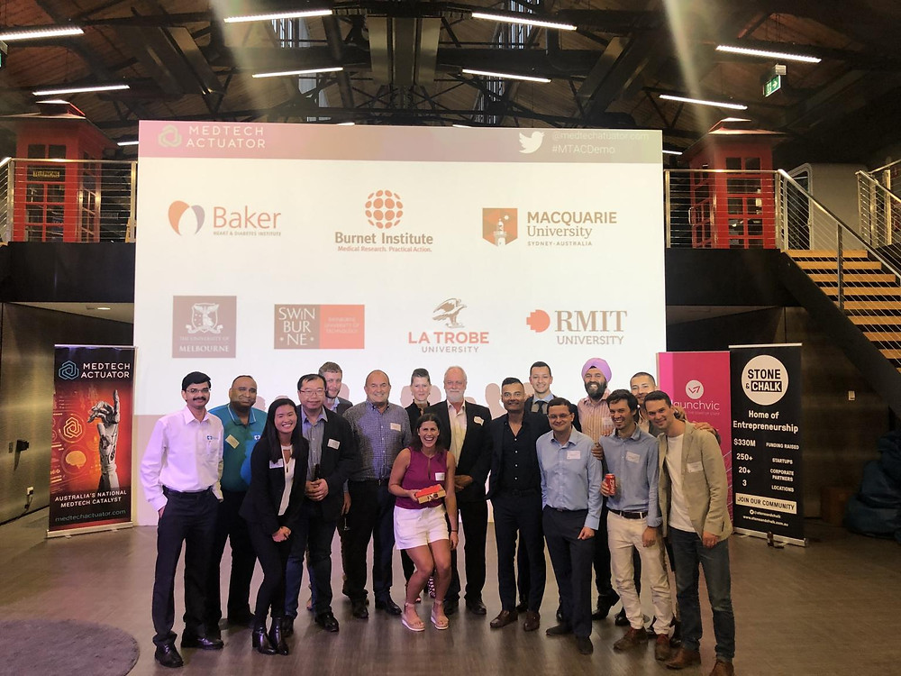 Multiple people from MedTech Actuator standing together at pitch night