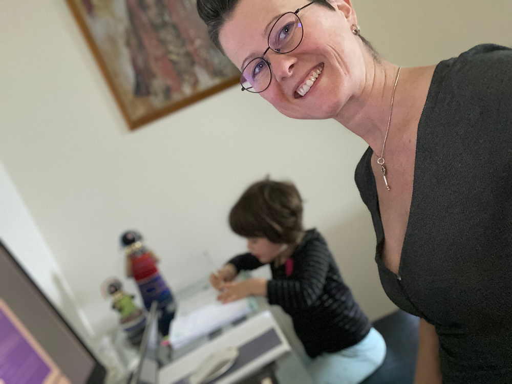 Founder Shannon working from home with her daughter