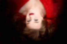 Keely lying down, red, with black fade.p