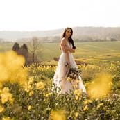 Bride in a rapeseed field
