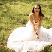 Bride sitting down smiling