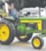 earl on tractor.jpg