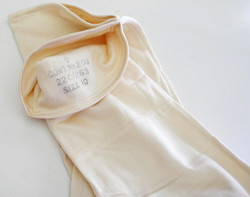 RAF silk inner gloves in unissued condition, still tacked together.