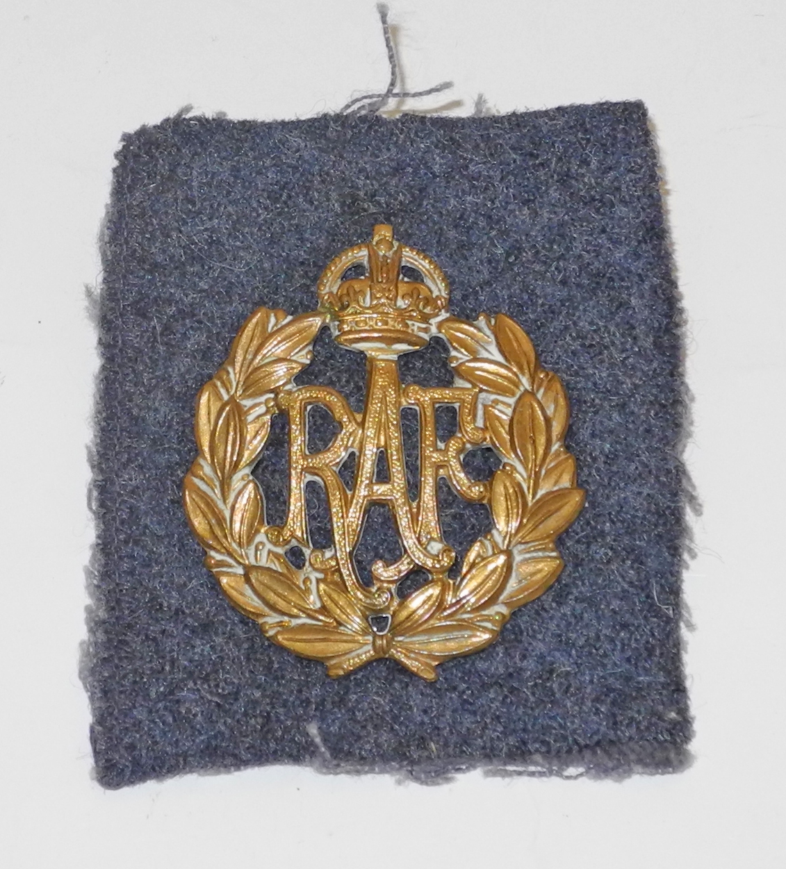 RAF OR cap badge with escape compass