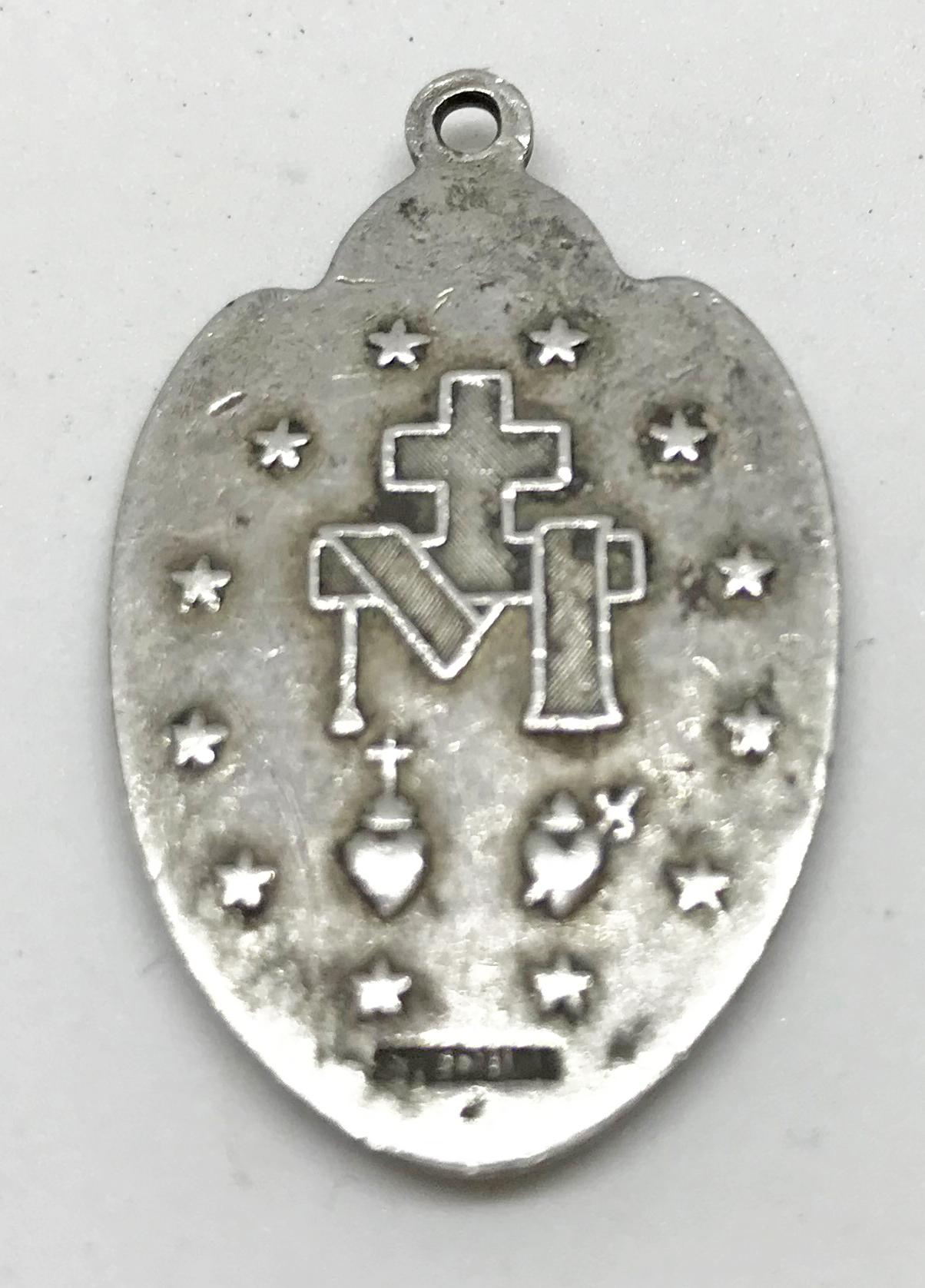 Sterling CBI religious pendant