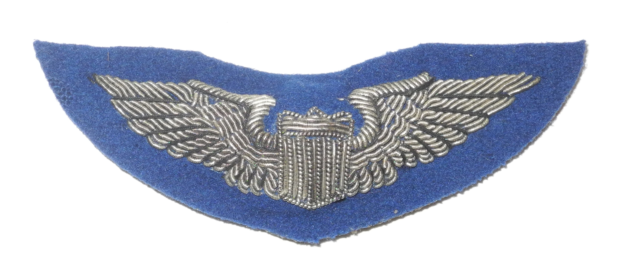Bullion embroidered AAF pilot wing on blue backing
