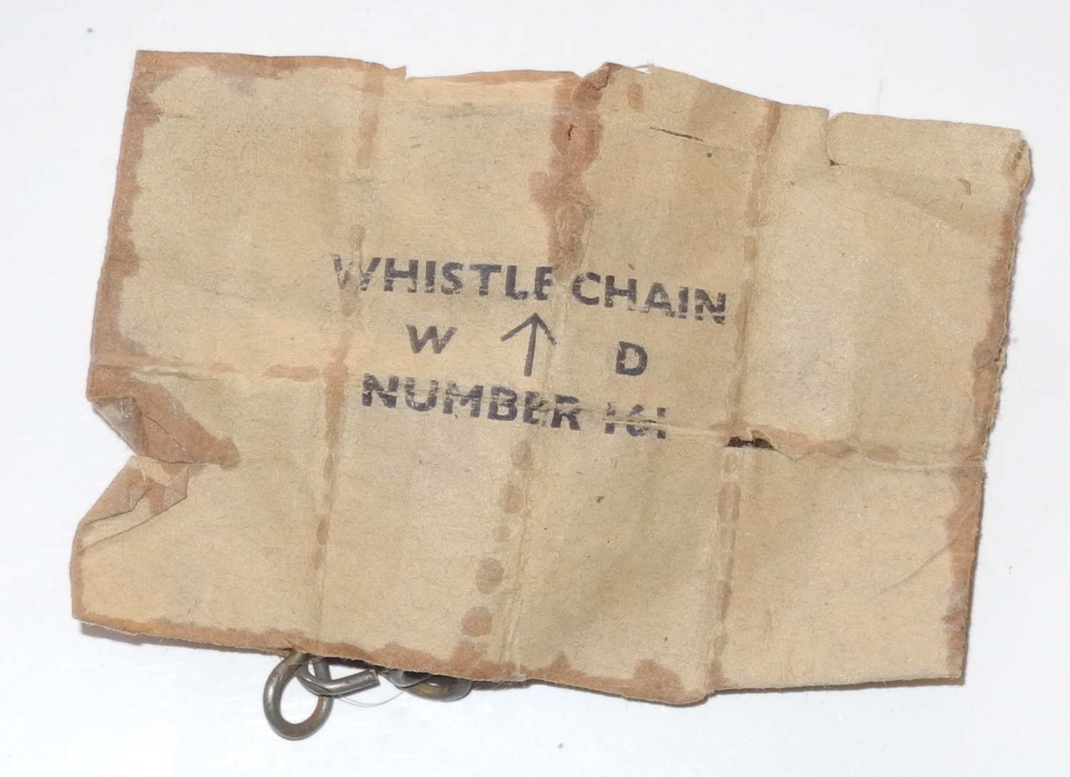 Whistle chain with paper packet