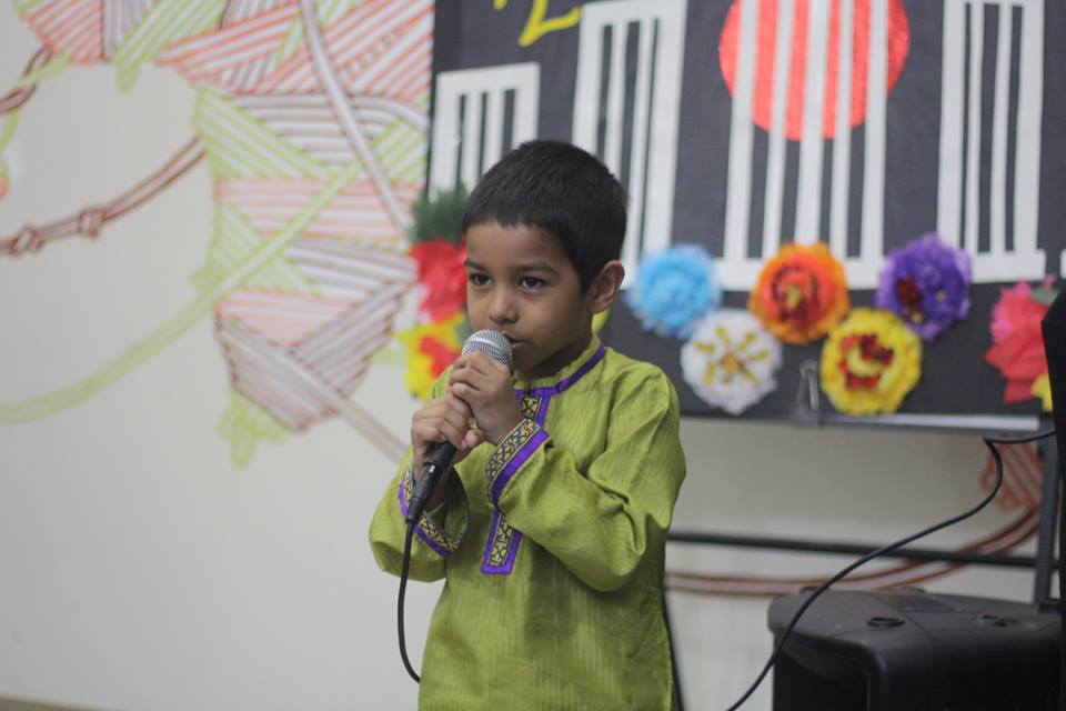 Child singing at community event