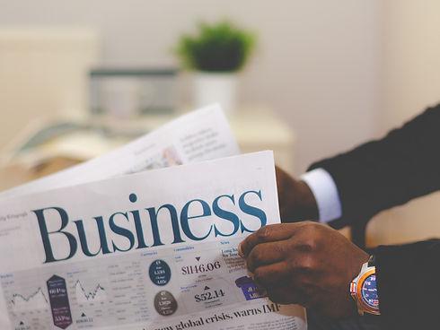 Businessman%20opening%20a%20paper_edited.jpg