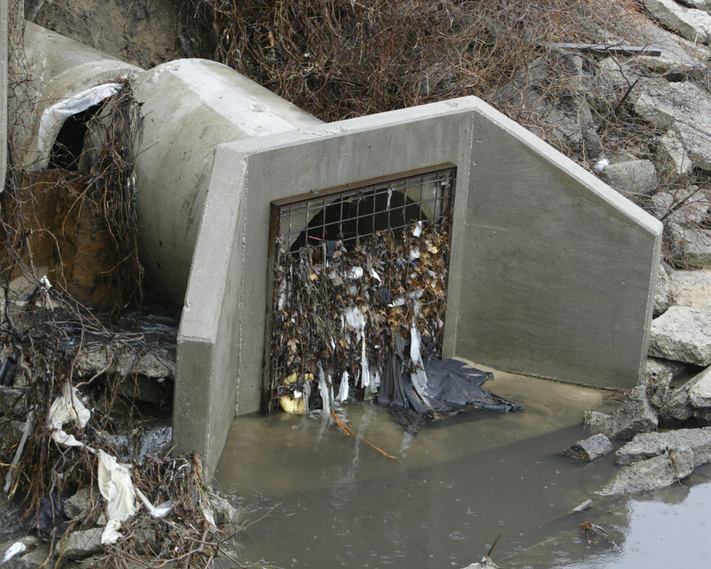 A Parking Lot Flood Can Be Caused By Clogged Storm Drain