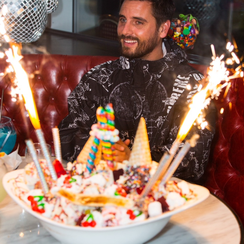 Scott Disick with Sugar Factory's signature King Kong sundae at the Pentagon City grand opening event by John Robinson