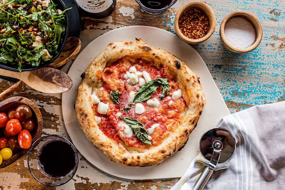The Local Pizzaiolo Offering A Month of Free Pizza for 2 in Honor of Friday's National Pizza Day