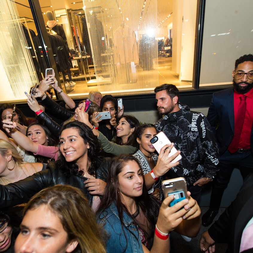 Scott Disick poses for selfies with fans at Sugar Factory Pentagon City grand opening event by John Robinson