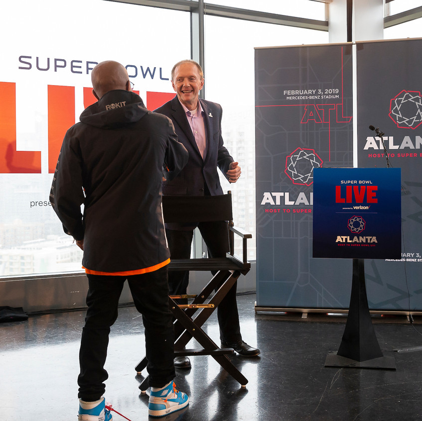 Jermaine shaking hands with Atlanta Supe