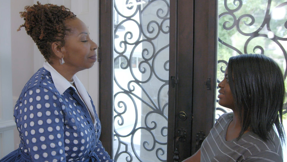 Iyanla Vanzant greets Kamiyah Mobley, a young girl who was kidnapped at birth and raised by a woman who was not her mother.