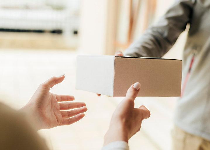 close-up-hands-getting-box.jpg