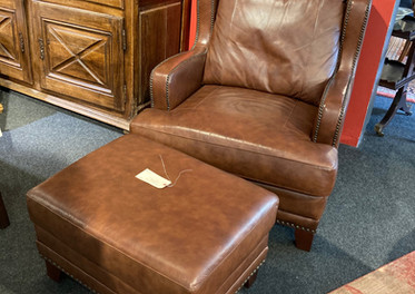Substantial fine quality leather chair & ottoman. Classic Styling