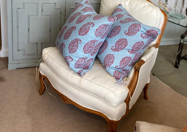 French Bergere chair, new upholstery/ Lee Joffa pillows, pair/ Garden pineapples, pair