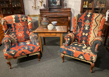 Kilim covered wingback chairs