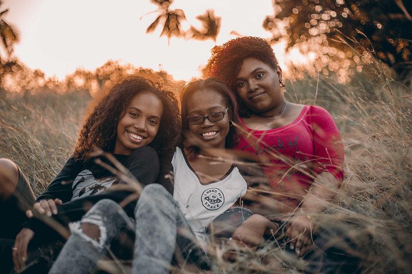 three-women-sitting-on-grass-1436618.jpg