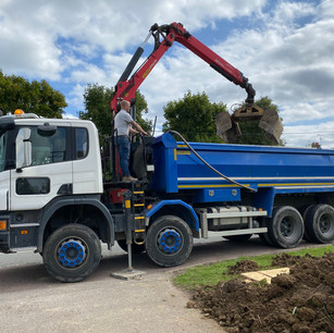 Grab lorry removing old soil