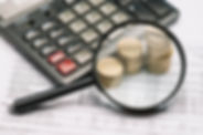magnifying-glass-coin-stack-calculator-f