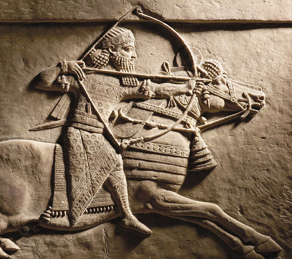 Assyrian relief showing warrior sitting on a horse pulling a bow and arrow