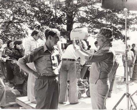 Image of Col. John Waddy speaking to Richard Attenborough on the set of the film A Bridge too Far