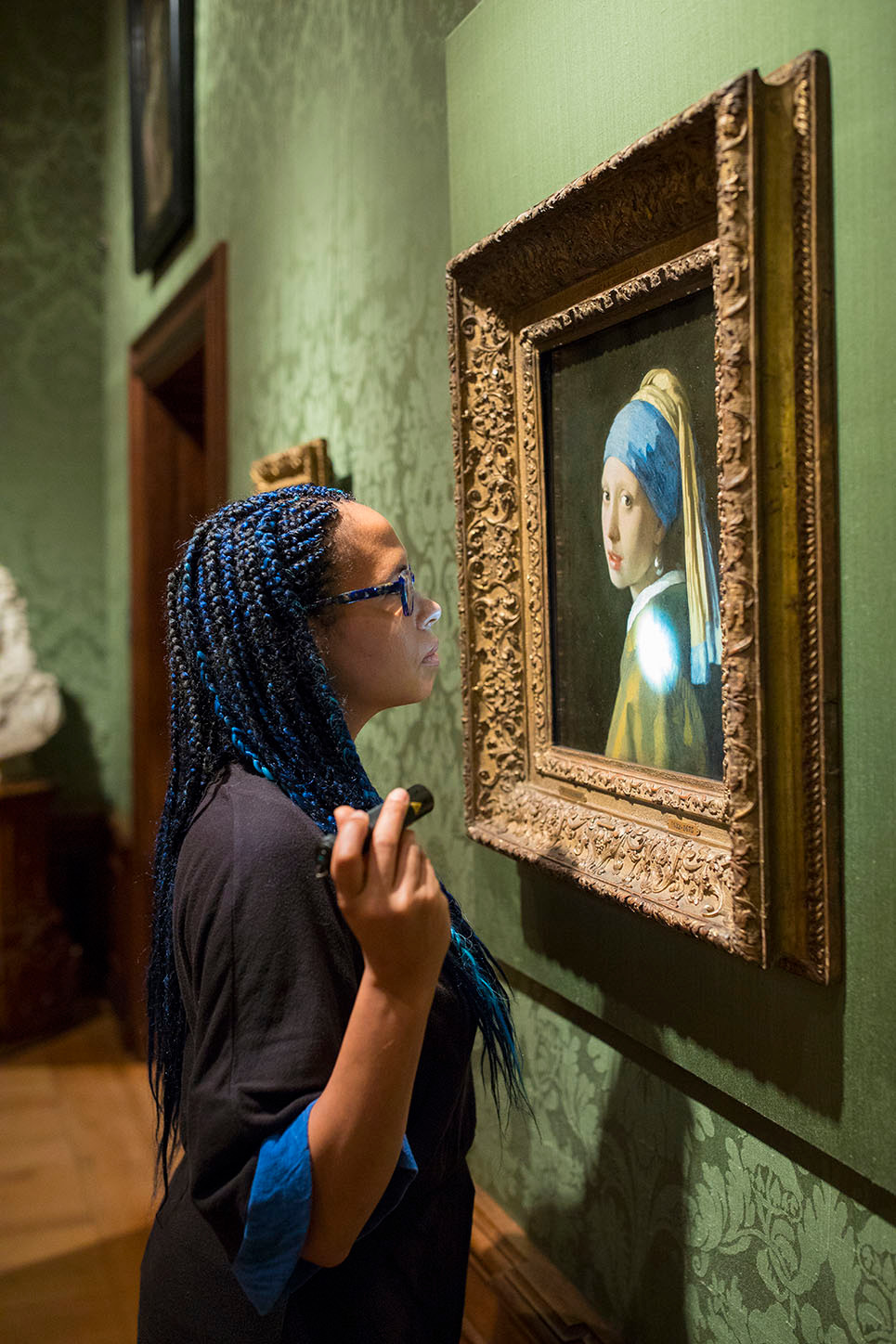 Head researcher Abbie Vandivere examines Girl with a Pearl Earring.
