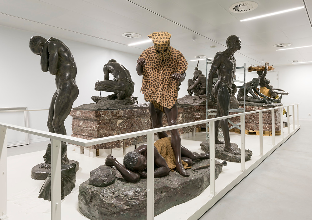 statues depicting native Congolese from original museum displays