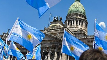Of Apprentice, Associate and Argentina's Debt Crisis
