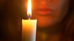The woman with burning candle. close-up,