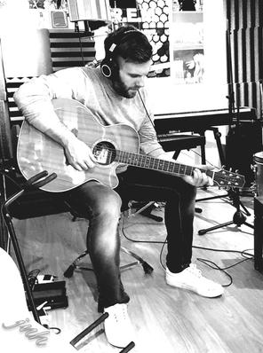 At Ben Haynes' studio in Derby, between takes for one of my albums. I can't not pick up a guitar that's laying around.