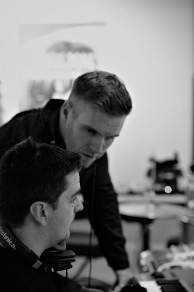 With Ben Haynes discussing something during the recording of The Best Is Yet To Come. He was probably saying 'That was a rubbish take, I knew I shouldn't have worked with you...'