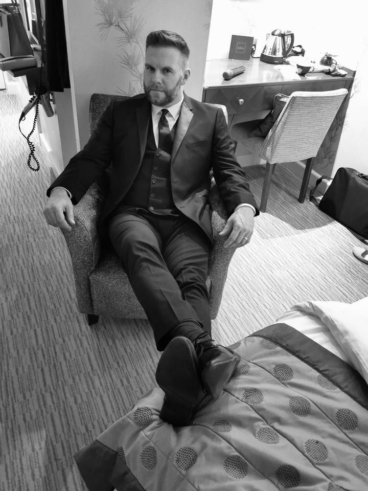 Chilling before a show, trying to look comfortable in a tight three-piece suit...